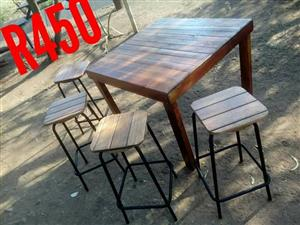 Wooden pallet table with 4 high chairs
