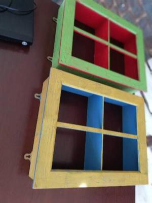 Two wooden window shaped shelves for sale