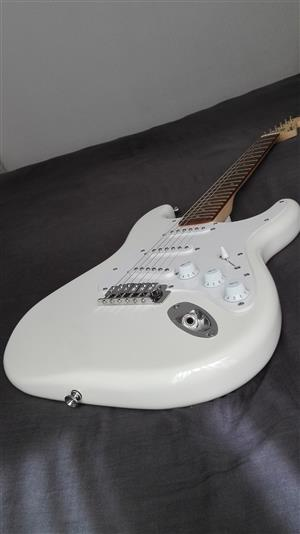 Squier Fender Strat electric guitar.