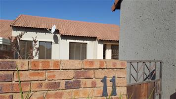 Three bedroom two bathroom double garage townhouse with private garden in security complex