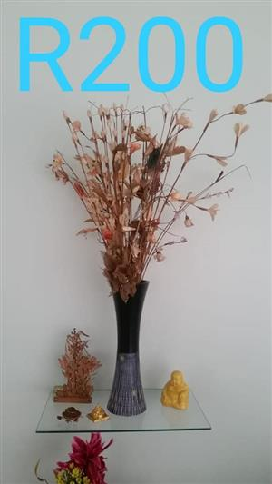 Vase with fake flowers and mini ornaments