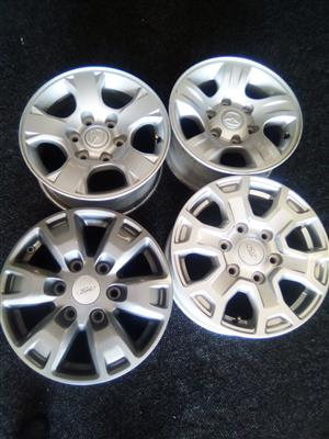 16 inch x4 new grey Ford mags
