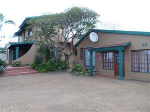 Double story house and separate large cottage for sale in Uvongo