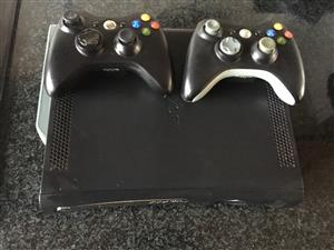Xbox 360 with 2 remotes for sale