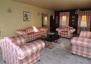 7 Seater Lounge suite in emasculate condition with palmis and matching curtains