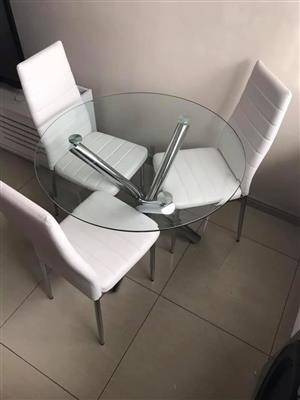 Tempered glass top dining table with chrome legs plus 3 comfy chairs for sale'