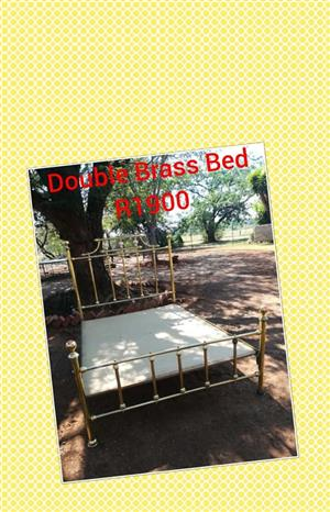 Double brass bed for sale.