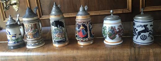 Collectable beer mugs with metal lids
