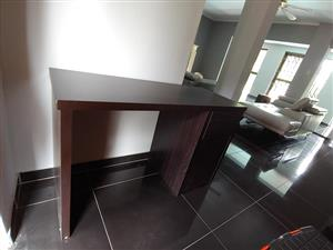 Dark wooden desk with cabinet