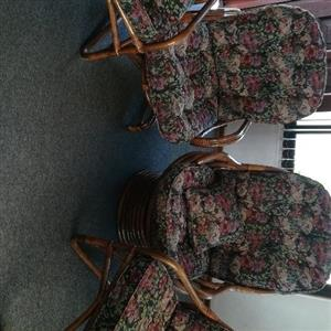 4 Piece cane set with cushions.