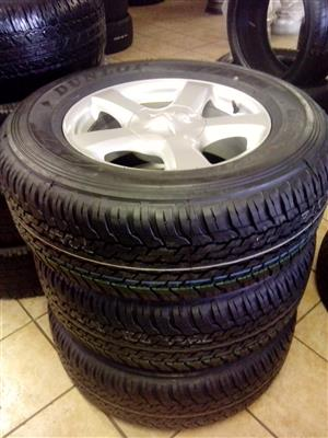Isuzu 18 inch rims with 265/65/18 Dunlop brand new tyres R8999 set with free fitment.