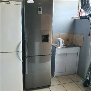 Samsung metallic silver fridge-freezer with water dispenser