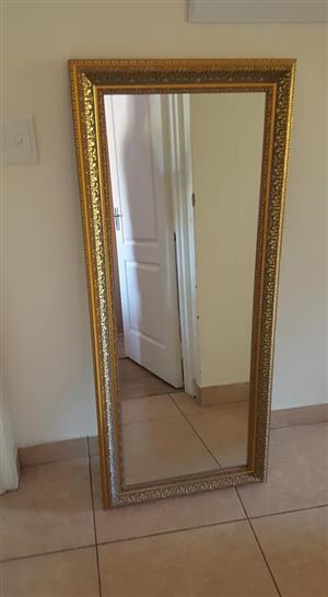 Tall golden framed mirror
