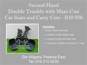Second Hand Double Trouble with Black Maxi-Cosi Car Seats and Carry Cots