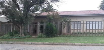 Family home with 3 flats rental income in Bothaville.
