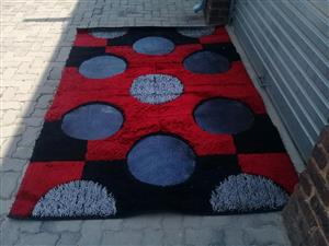 Red,black and blue carpet for sale