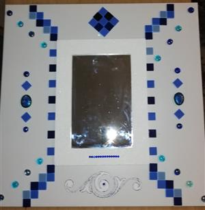 Mosaic design on tile and mirror