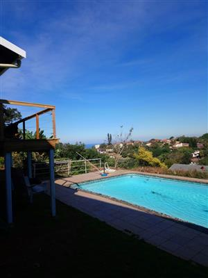 Warm inviting Durban North suite with valley and seaviews