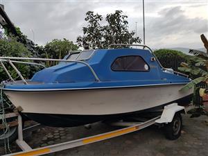 Cabin boat on trailer with enjine