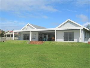 Immaculate 5 bedroom, 5 Bathroom  Home - On the Beach- with 1 Bedroom Cottage  for sale in Port Edward.