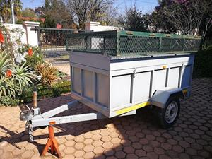Good condition trailer with cage