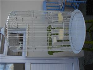 Parrot cage used for an African Grey 1 m high it is clean and in a good condition