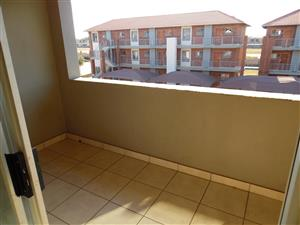 Two bedroom full bathroom corner top floor flat with covered parking in Stone gate