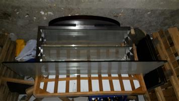 Glass topped designer coffee table