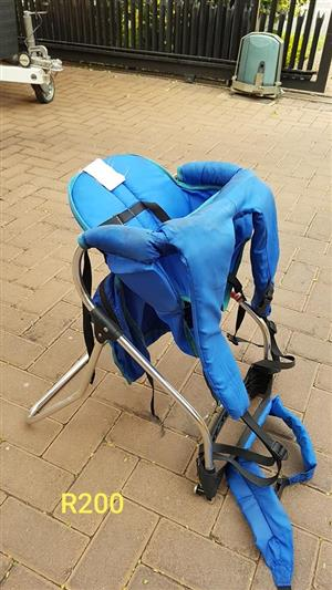 Blue strap on feeding chair for sale