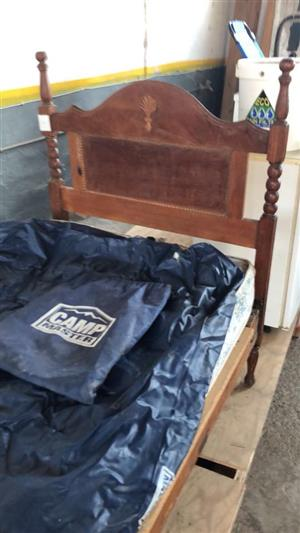 Antique single bed with camp master sleeping bag
