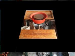 Potters wheel with lots of bags of clay imported model
