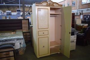 Beige 2 door clothing cupboard