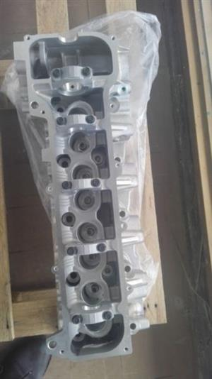 BRAND NEW BARE AND COMPLETE CYLINDER HEADS