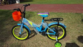 Blue and lime green kiddies bike with red basket