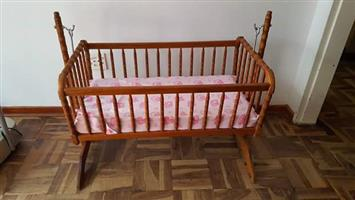 Wooden rocking baby crib