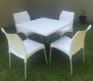 Table laminated with plastic  and Plastic Chairs
