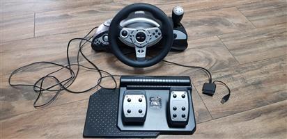 PS3 steering Wheel plus 12 games