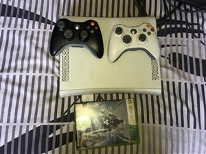 Xbox 360 2 remotes and 1 game