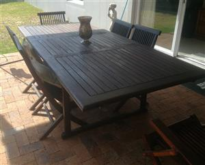 8 seater wooden table with 6 chairs