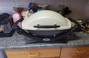 Brand New Weber Q1000 Titanium Gas Grill with 9kg LPG Bottle Included in sale...