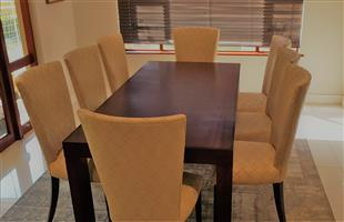 Solid wooden mahogany 8 seater Dining table, 2m x 1m. Chairs are covered with a modern material