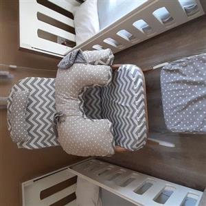 cots, rocking chair and compactum