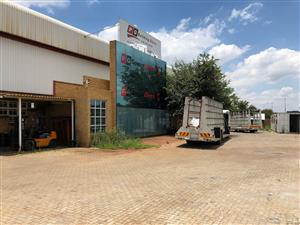 FOR SALE: LARGE WAREHOUSE / FACTORY / DISTRIBUTION CENTRE FOR SALE IN HENNNOPS PARK, CENTURION, WITH HIGHWAY EXPOSURE!