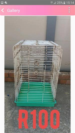 Rusted green and white parrot cage