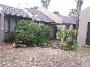 Stunning 4 Bedroom house ,2 living areas, 2 dining rooms, 3 bathrooms , 2 lockup garages ,Carports for 5 cars &swimming pool ,Lapa ,BAR and garden for RENTAL at the REEDS, CENTURION