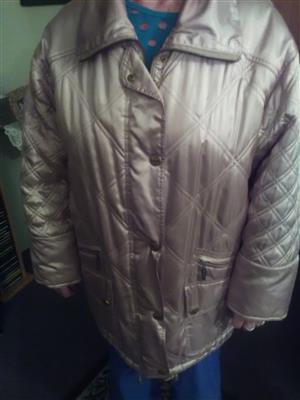 Shiny gold designer jacket by Berghaus fits 38 to 40