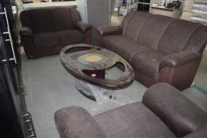 3 Piece brown lounge suite with coffee table