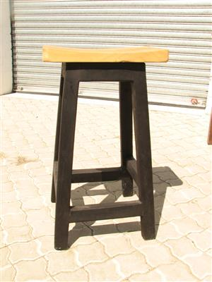 pine wooden saddle-seat bar stool.