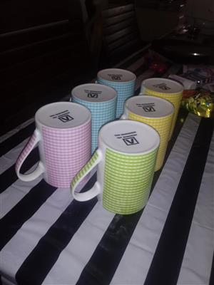 Various colored mugs for sale