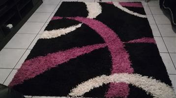 Black,pink and white carpet for sale